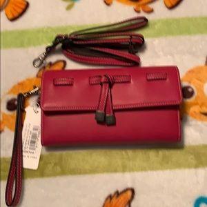 Pink crossbody or wristlet bag. 💗💗